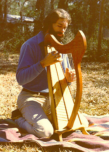Ross playing first harp